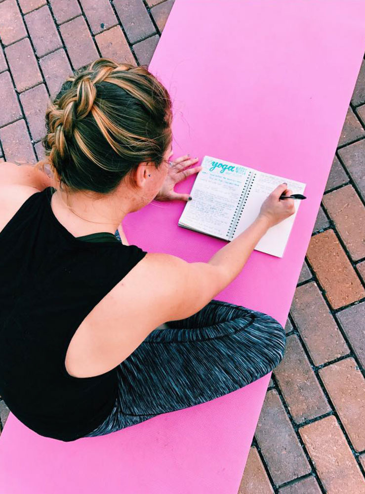 yoga client making notes